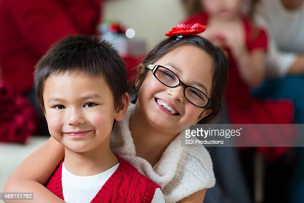 Asian brother and sister smiling at home on Christmas day