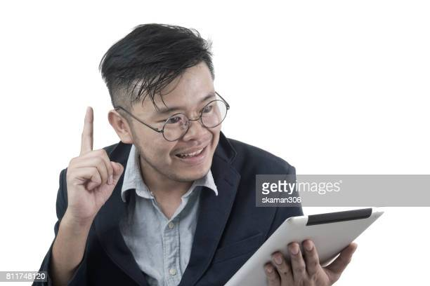 Asian business man  looking at tablet and start up thinking new plan and and new marketing idea with white background