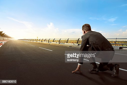 Asian business man ready to run : Stock Photo