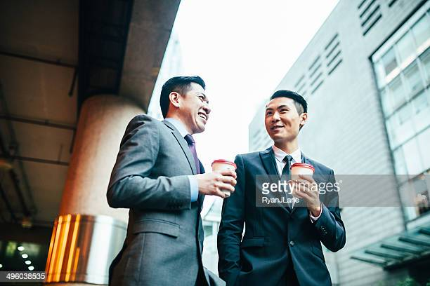 Asian Business Men Having Discussion