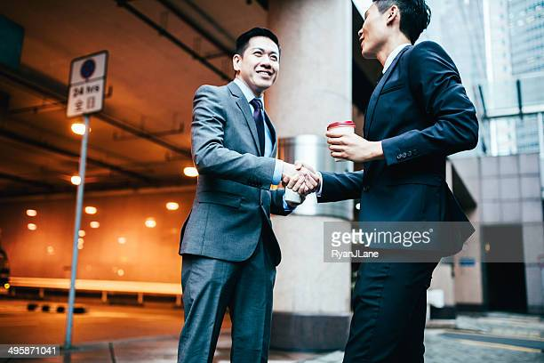 Asian Business Men on Shaking Hands
