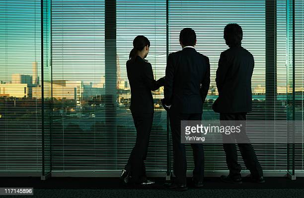 Asian Business Office Workers Silhouetted, Looking at Tokyo City Skyline