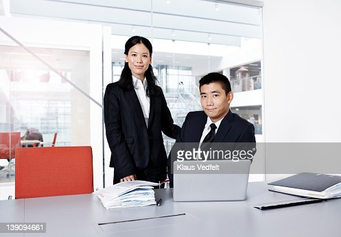 Asian business people at office looking in camera : Stock Photo