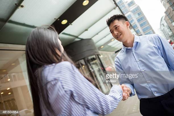 Asian business people handshaking
