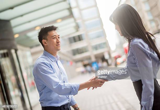 Asian business people handshaking