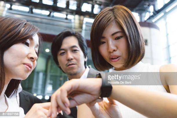 Asian business people looking at smartphone