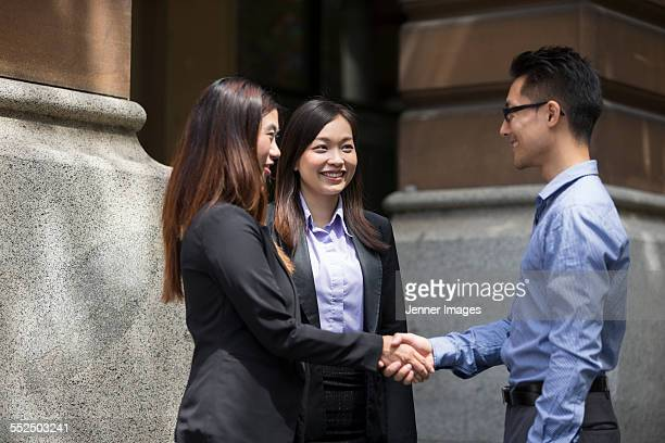 Asian Business people shaking hands.