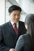 Asian business people talking