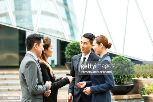 Asian Business Team Exchanging Business Card