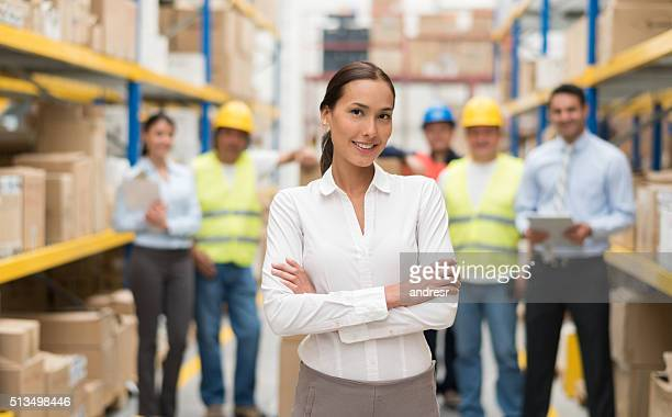 Asian business woman at a warehouse