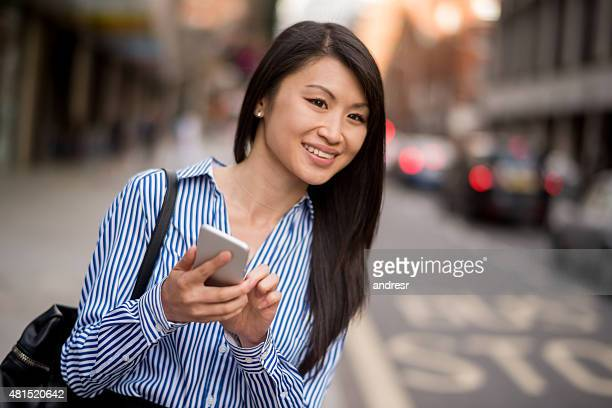 Asian business woman at the bus stop