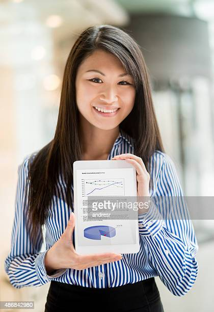 Asian business woman checking the company's progress