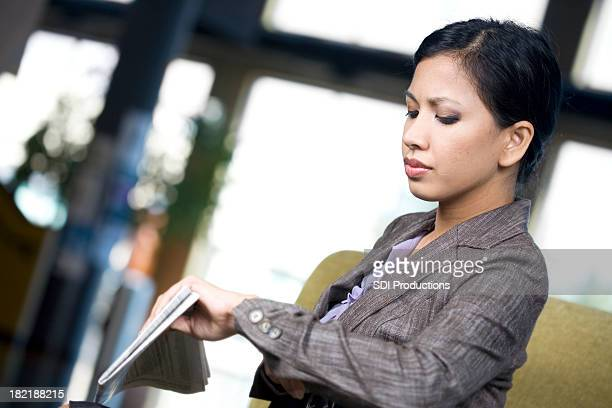 Asian Business Woman Checking the Time