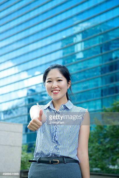 Asian Business woman thumbs up!