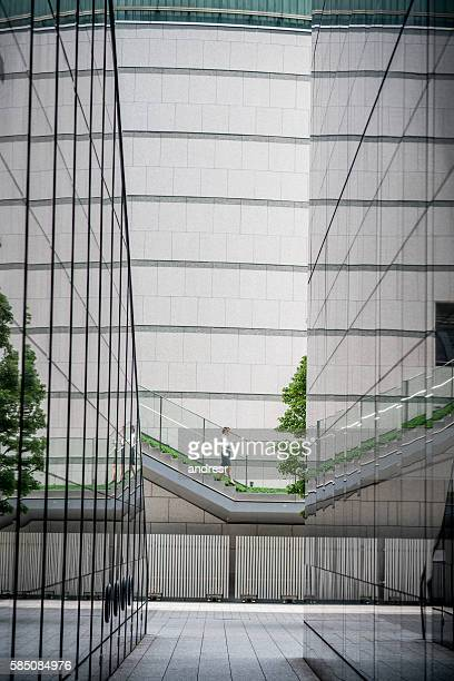 Asian business woman walking in a financial district