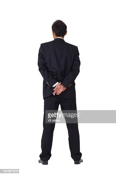 Asian businessman cross fingers