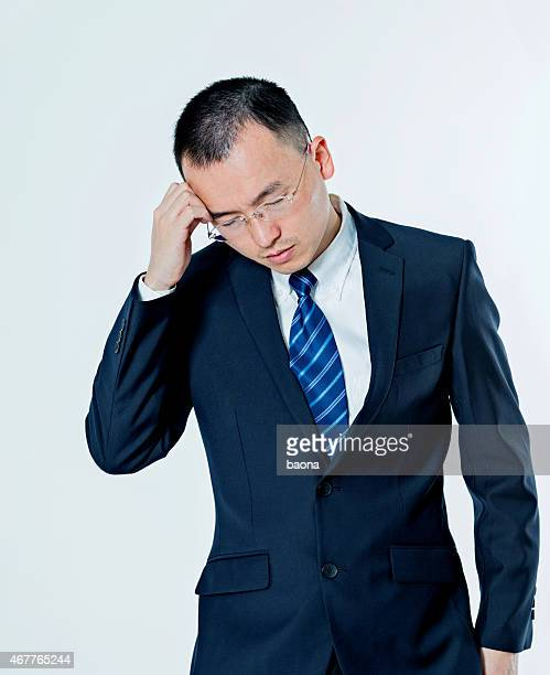 Asian businessman exhausted