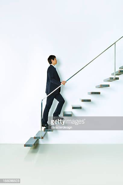 Asian businessman going up
