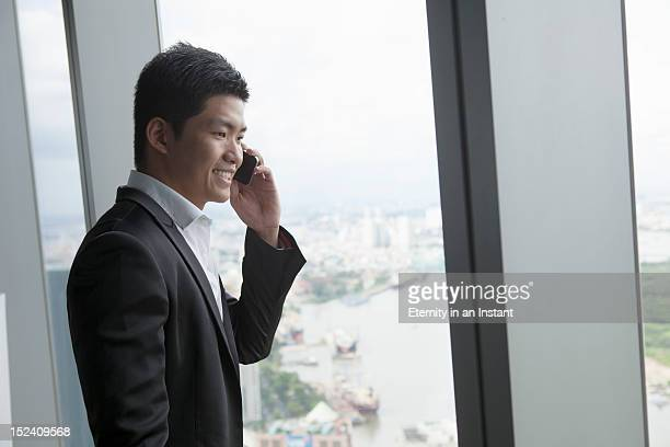 Asian Businessman holding smartphone