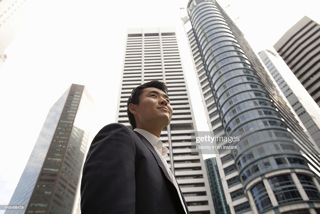 Asian Businessman in city with buildings : Stock Photo