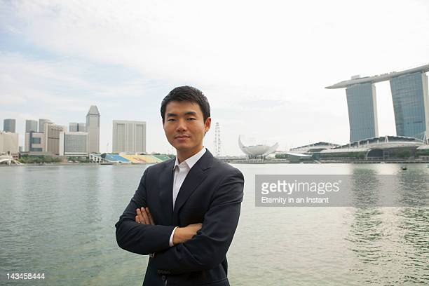 Asian Businessman in front of  Marina Bay