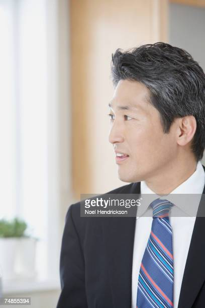 Asian businessman looking to side
