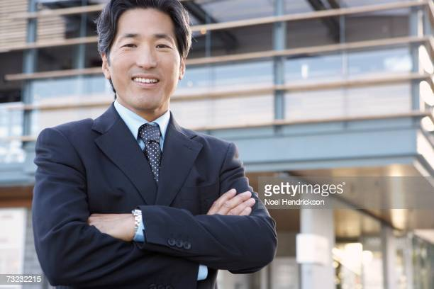 Asian businessman smiling outdoors