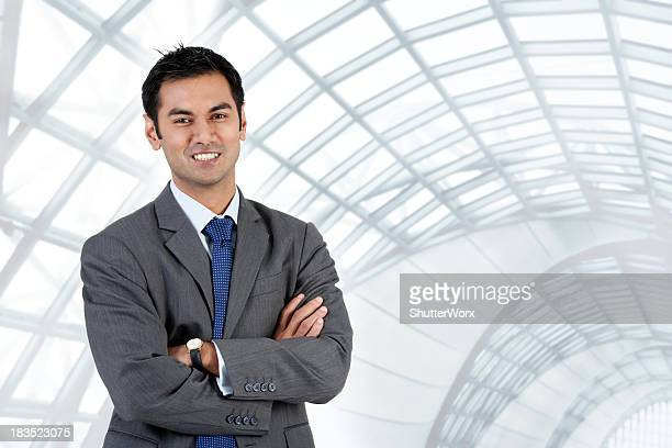 Asian Businessman Standing With His Arms Folded
