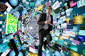 Asian businessman surrounded by science images