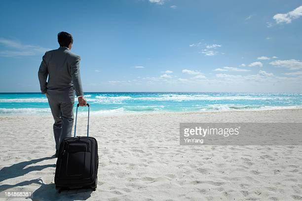Asian Businessman Vacationing in Tropical Caribbean Beach