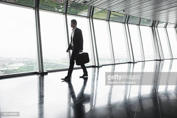 Asian Businessman walking with briefcase