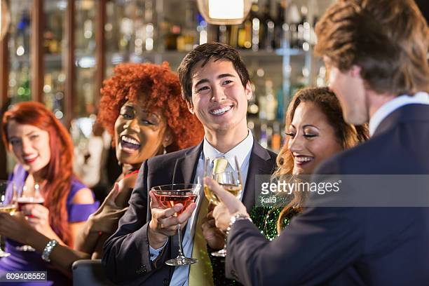 Asian businessman with friends at bar