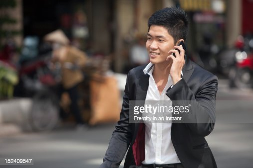 Asian Businessman with smartphone in  street : Stock Photo