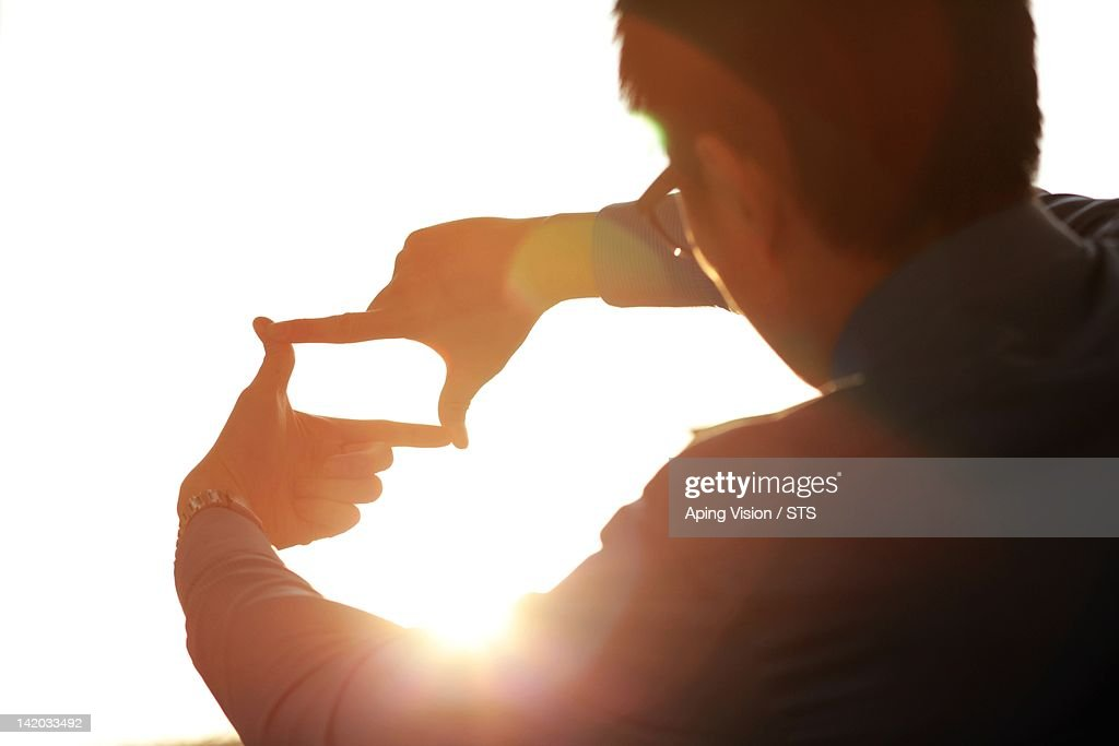 Asian businessman with sunshine : Stock Photo