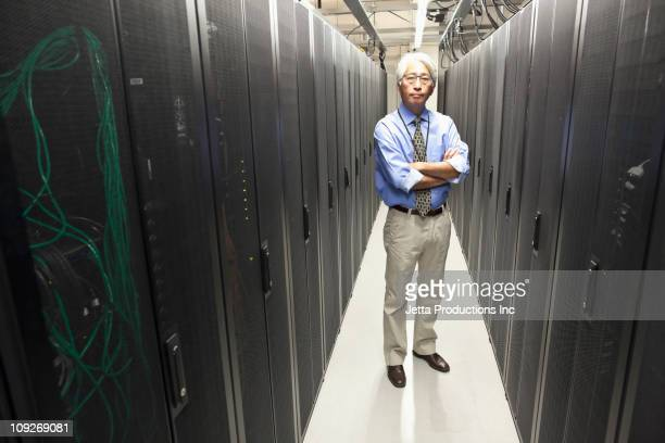 Asian businessman working in office technology room