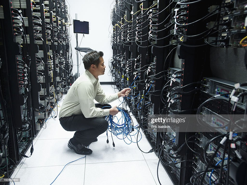 Asian businessman working in server room