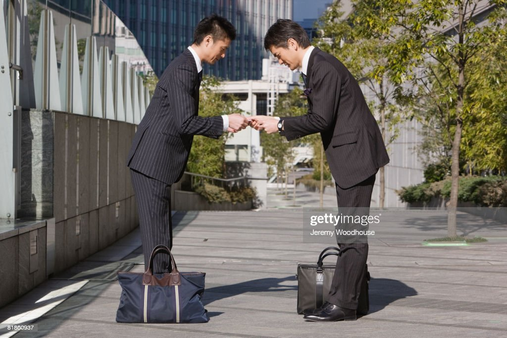 Asian businessmen bowing