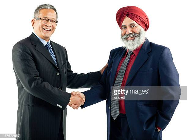 Asian Businessmen Shaking Hands - Isolated