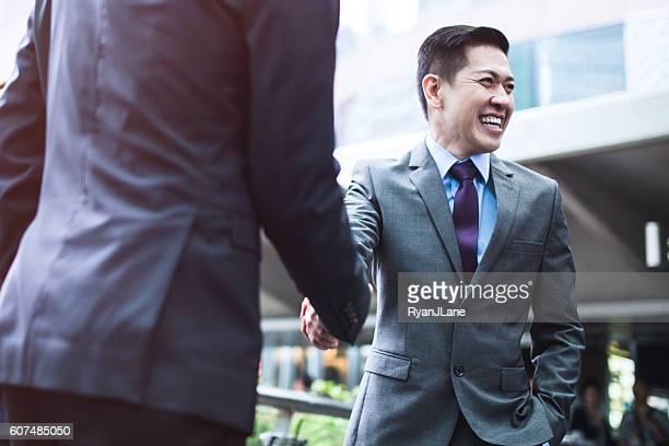 Asian Businessmen Shaking Hands