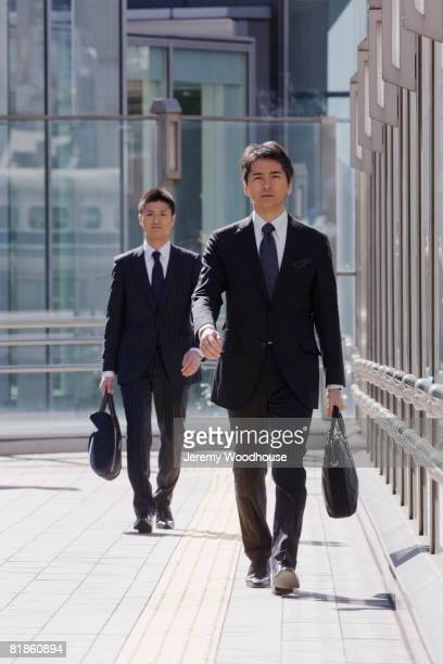Asian businessmen walking outdoors