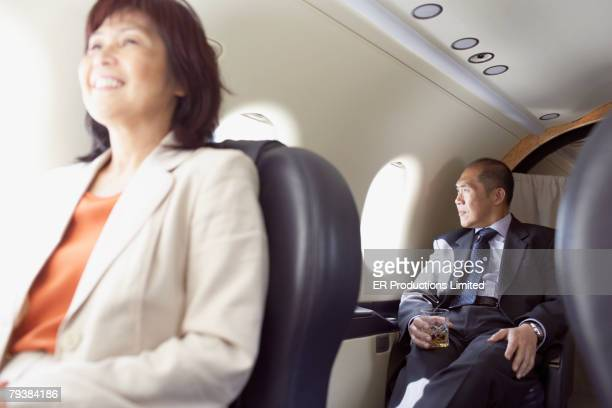 Asian businesspeople on airplane
