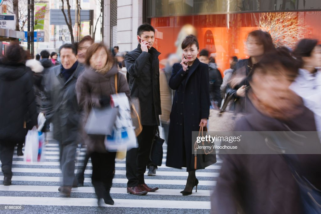 Asian businesspeople talking on cell phone