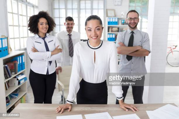 Asian businesswoman and team