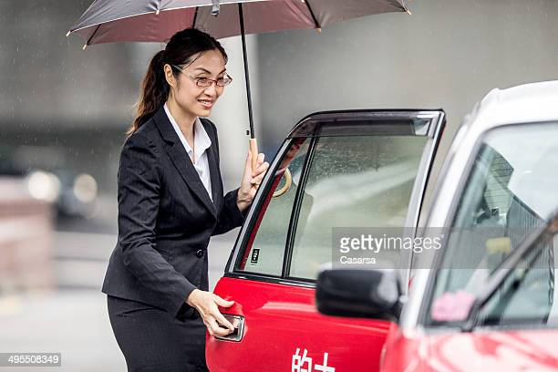 Asian Businesswoman calling a taxi