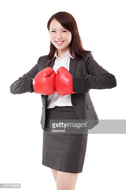 Asian Businesswoman in Boxing Gloves on White Background