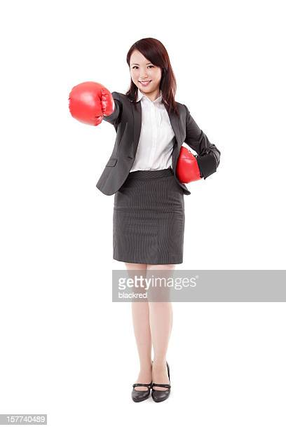 Asian Businesswoman in Boxing Gloves Punching on White Background