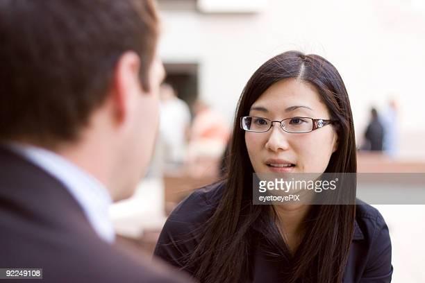 Asian businesswoman in conversation