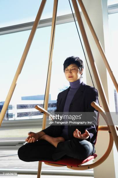 Asian businesswoman meditating