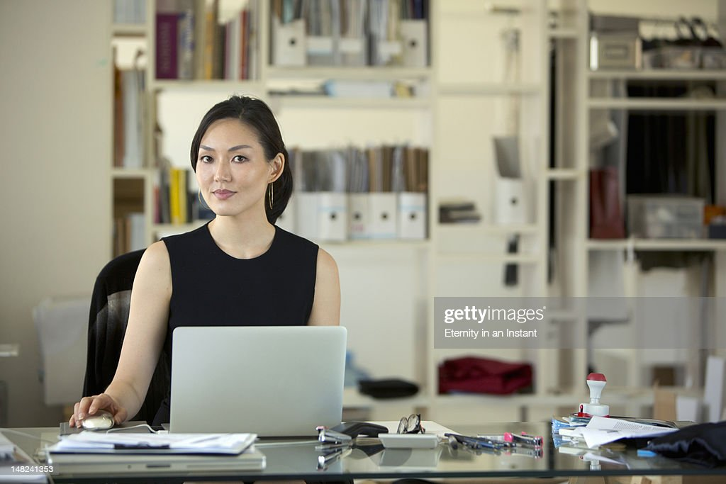 Asian Businesswoman on laptop computer in office : Stock Photo