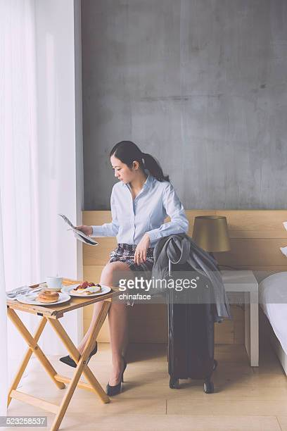 asian businesswoman reading newspaper